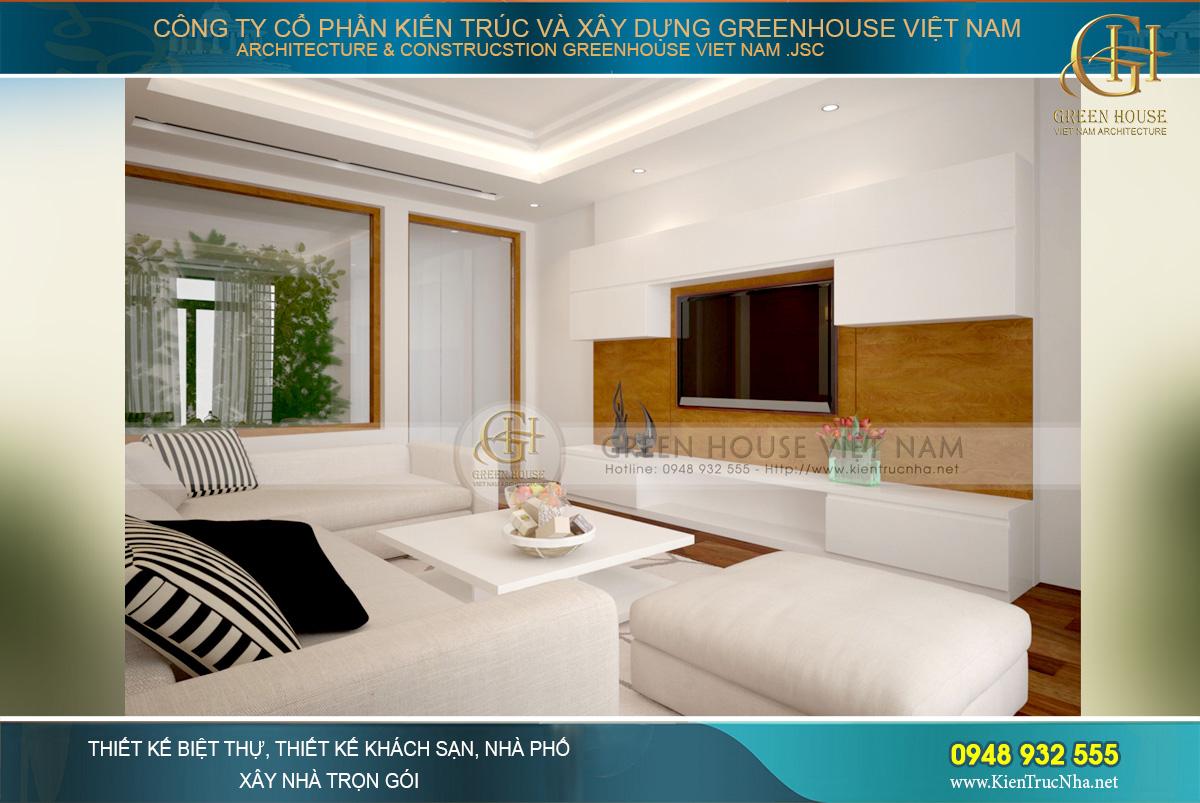 Không gian phòng khách tràn ngập sắc trắng với những mảng màu nâu – đen tạo điểm nhấn