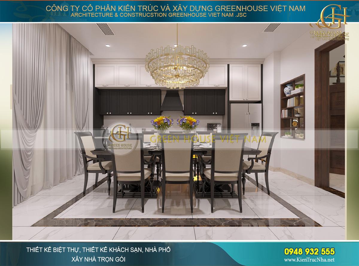 Khu vực kệ bếp được thiết kế đồng bộ với bàn ăn bằng chất liệu gỗ sơn đen lịch lãm