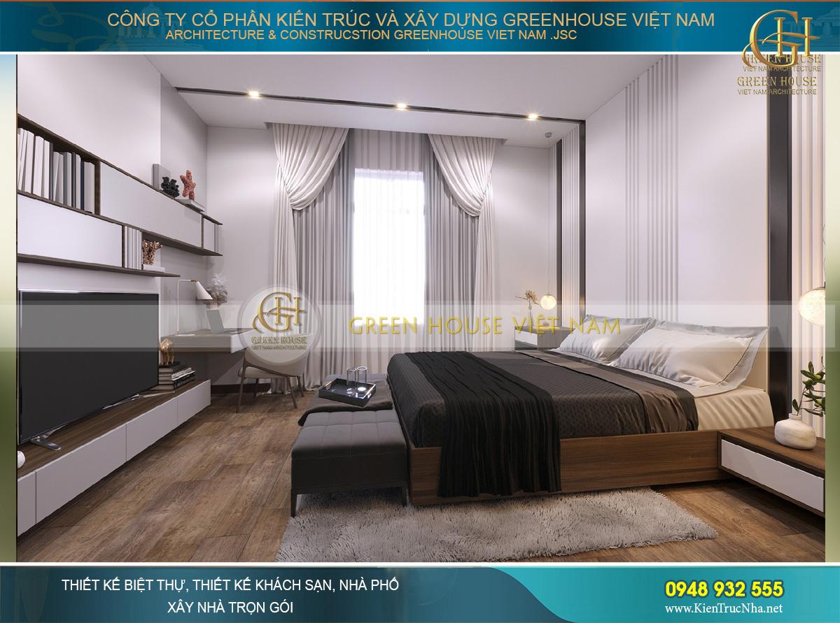 Khung cửa kính lớn và nước sơn tường trắng giúp căn phòng được điều hòa và có điểm nhấn