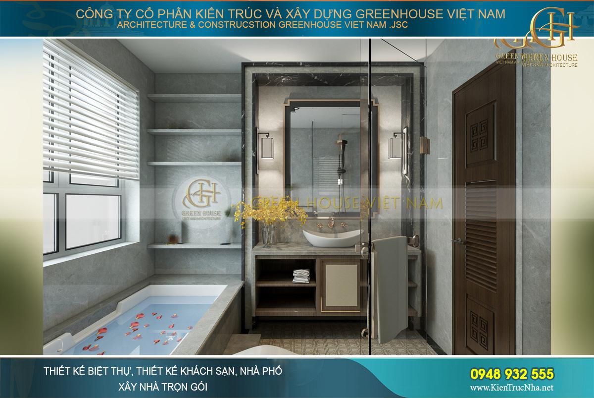 Phòng tắm được bố trí kệ để đồ, gương soi và phòng tắm kính và bồn tắm lớn hiện đại
