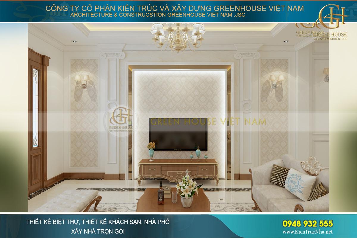 Đối diện sofa là kệ TV với chất liệu và thiết kế đồng bộ