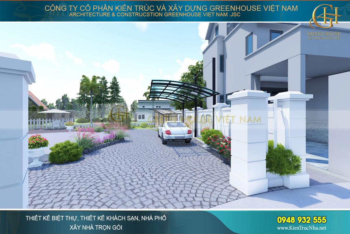 Từ hướng cổng biệt thự đi vào sẽ dẫn tới khu vực gara ô tô ngoài trời với mái che bằng kính cường lực