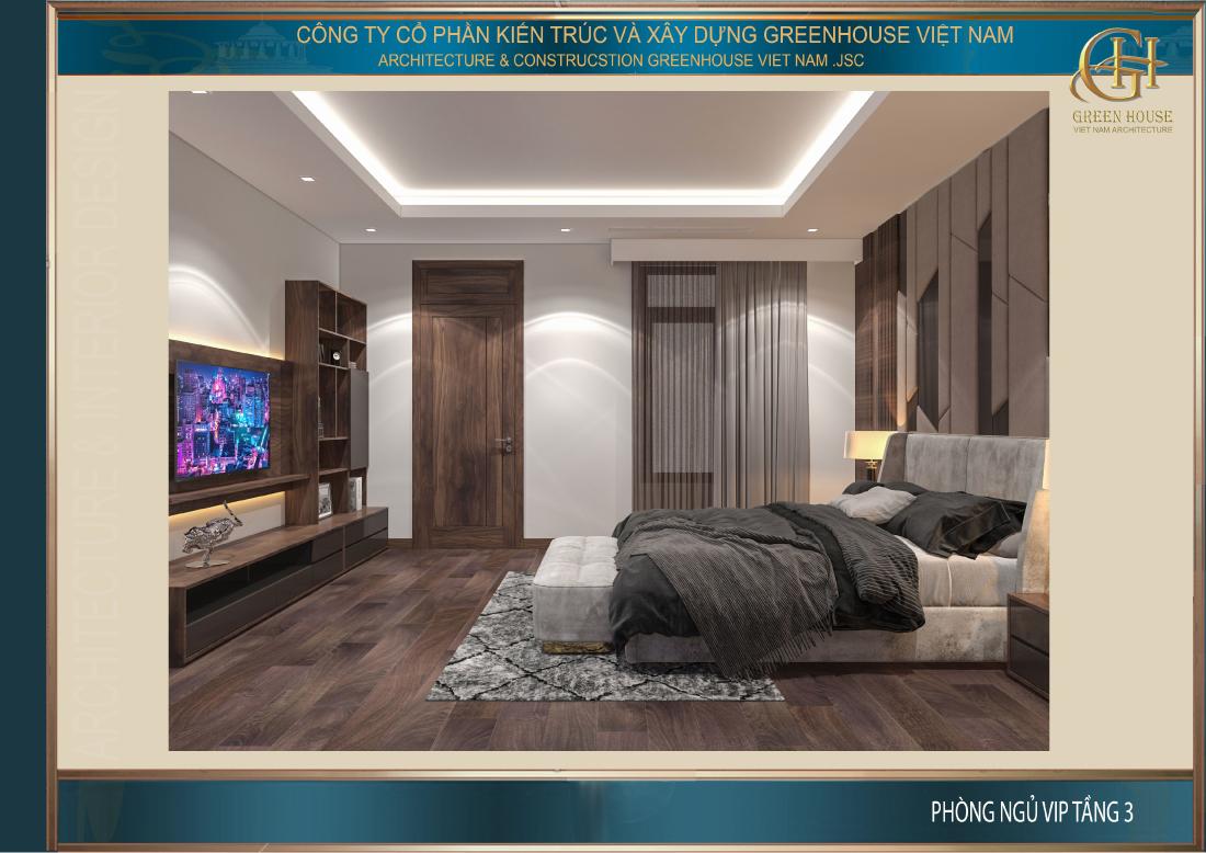 Đối diện giường ngủ là kệ sách và TV treo tường